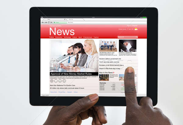 Person Watching News On Digital Tablet Stock photo © AndreyPopov