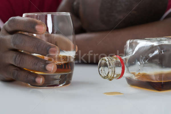 Man Holding Glass Of Whisky Stock photo © AndreyPopov