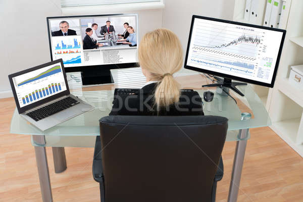 Businesswoman Video Conferencing On Computer Stock photo © AndreyPopov