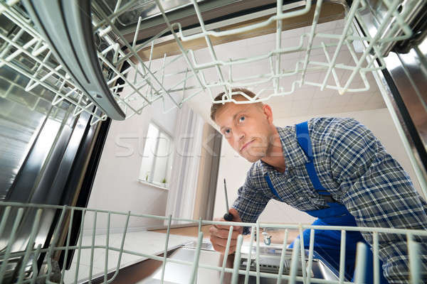 Technician Repairing Dishwasher Stock photo © AndreyPopov