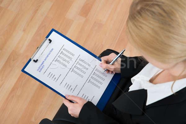деловая женщина заполнение клиентов обзор форме Сток-фото © AndreyPopov