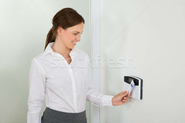 Businesswoman Inserting Keycard In Security System Stock photo © AndreyPopov