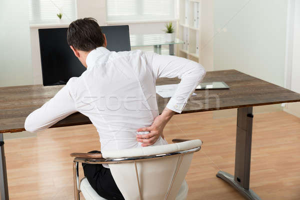 Businessman Suffering From Backache At Desk Stock photo © AndreyPopov