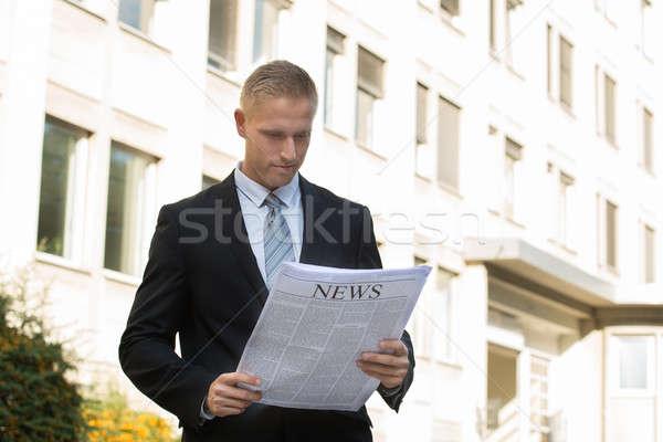 Businessman Reading Newspaper Stock photo © AndreyPopov