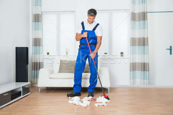 Janitor Sweeping Crumpled Papers On Floor Stock photo © AndreyPopov