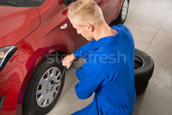 Mechanic Changing Tire In Garage Stock photo © AndreyPopov
