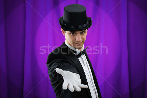 Portrait Of Magician Gesturing Stock photo © AndreyPopov