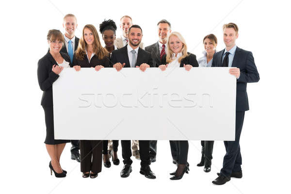 Confident Multi ethnic Business Team Holding Blank Billboard Stock photo © AndreyPopov