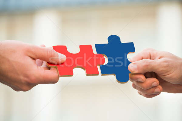 Businessmen Joining Jigsaw Pieces Stock photo © AndreyPopov