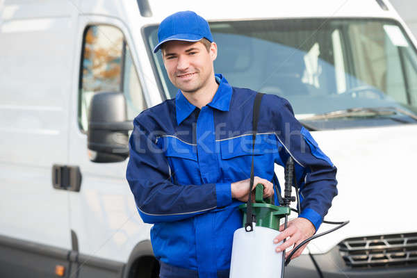 Pest Control Worker With Pesticide Against Truck Stock photo © AndreyPopov