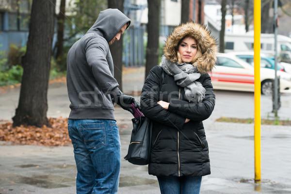 Ladrón embrague chaqueta calle jóvenes Foto stock © AndreyPopov