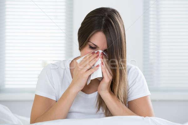 Femme froid moucher portrait jeune femme nez Photo stock © AndreyPopov
