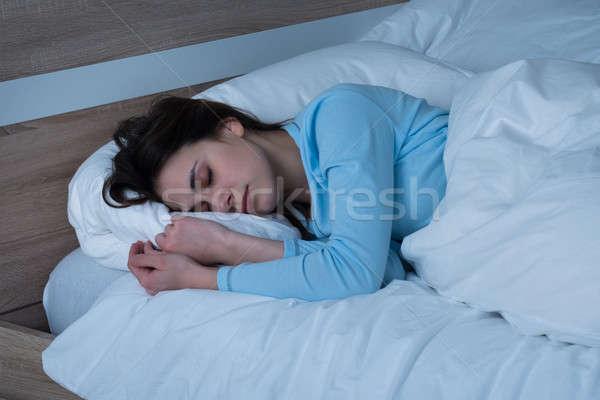 Woman Sleeping On Bed Stock photo © AndreyPopov