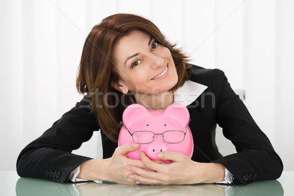 Zdjęcia stock: Kobieta · interesu · skarbonka · szczęśliwy · młodych · okulary