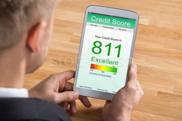 Businessman With Digital Tablet Showing Credit Score Stock photo © AndreyPopov