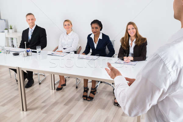 Businessperson Talking To Colleague Stock photo © AndreyPopov