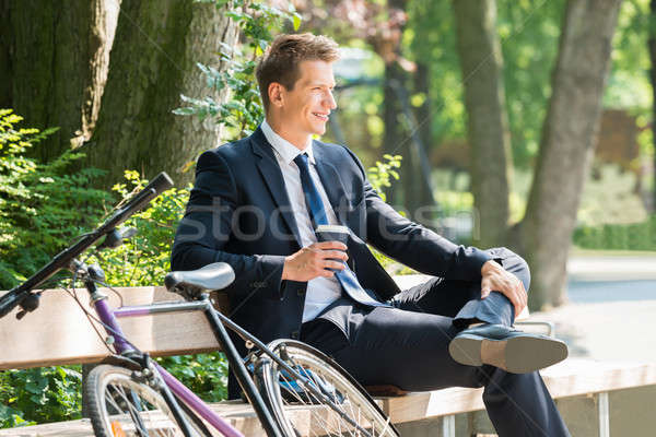 Businessman Sitting On Bench At Park Stock photo © AndreyPopov