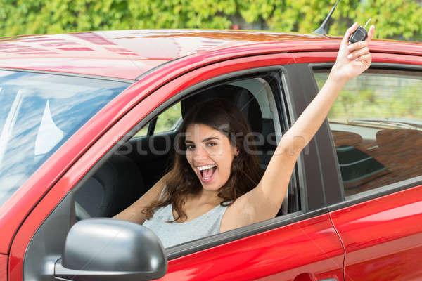 興奮した 女性 座って 車 肖像 ストックフォト © AndreyPopov