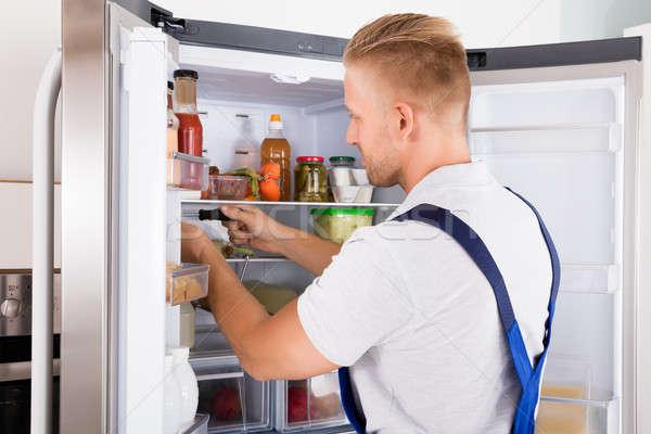 Repairman Checking Refrigerator Stock photo © AndreyPopov