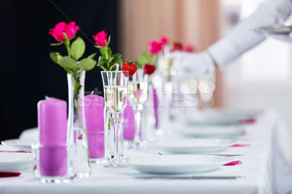 Champagne Glass On Decorated Wedding Table Stock photo © AndreyPopov