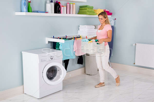 Woman With Basket Of Clothes In Utility Room Stock photo © AndreyPopov