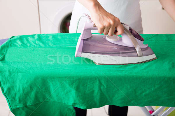Close-up Of Woman Ironing Green T-shirt Stock photo © AndreyPopov
