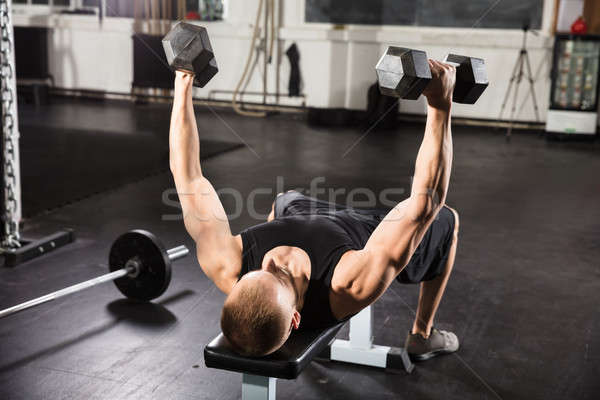 Young Man Working Out In Gym Stock photo © AndreyPopov
