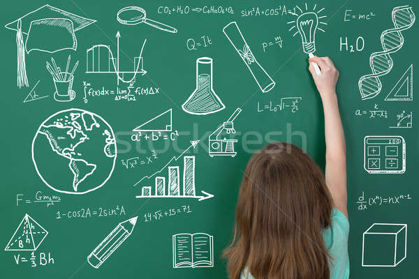 Girl Drawing On Green Chalkboard Stock photo © AndreyPopov
