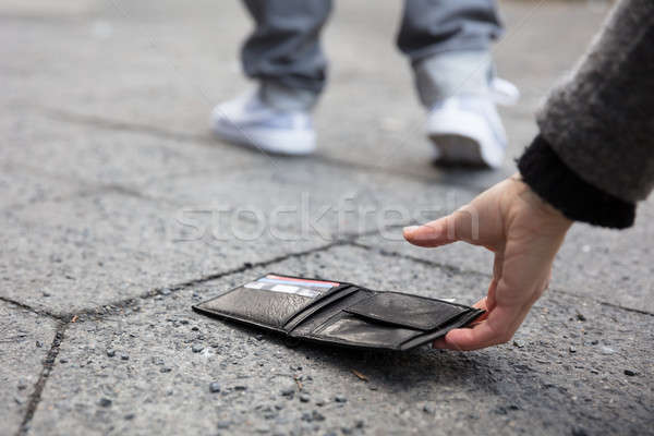 Person Picking Up A Lost Wallet Stock photo © AndreyPopov