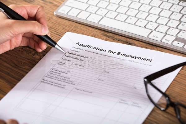 Person Filling The Employment Application Form Stock photo © AndreyPopov