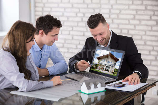 Architect Showing House Model To Couple In Office Stock photo © AndreyPopov