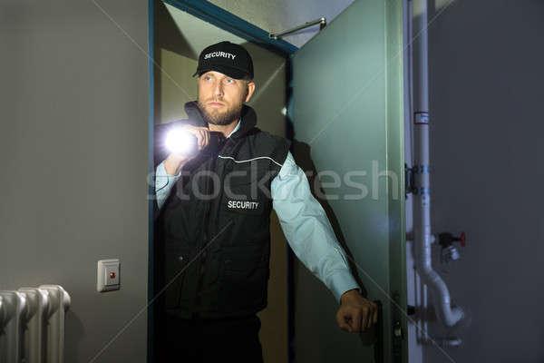 Güvenlik görevlisi arama el feneri oda erkek genç Stok fotoğraf © AndreyPopov
