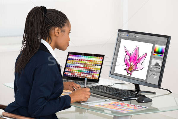 Female Designer Drawing Flower On Computer Using Graphic Tablet Stock photo © AndreyPopov