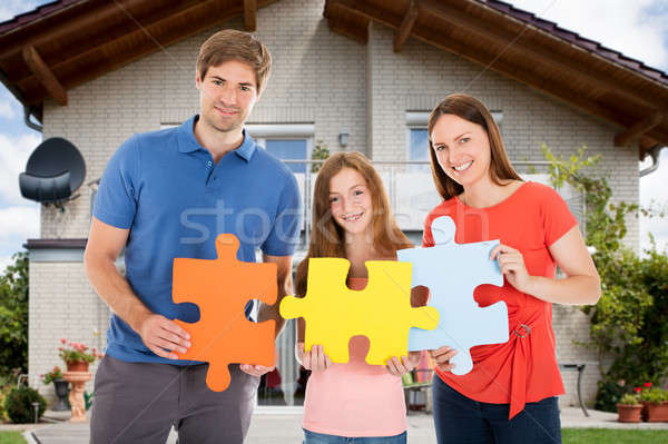 Stock photo: Happy Family Holding Colorful Jigsaw Puzzles