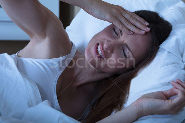 Close-up Of A Female Suffering From Migraine Stock photo © AndreyPopov