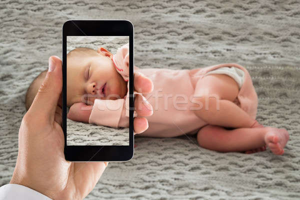 Person Capturing Picture Of A Sleeping Baby Stock photo © AndreyPopov