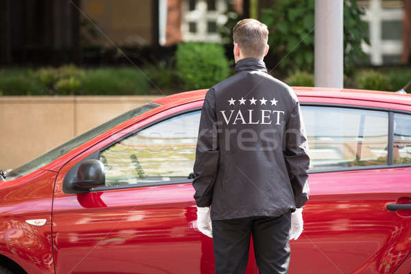 Valet Standing In Front Of Car Stock photo © AndreyPopov