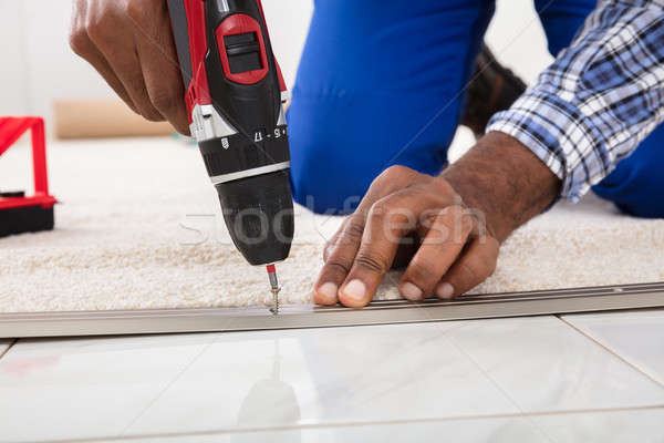 Hand Installing Carpet On Floor Stock photo © AndreyPopov