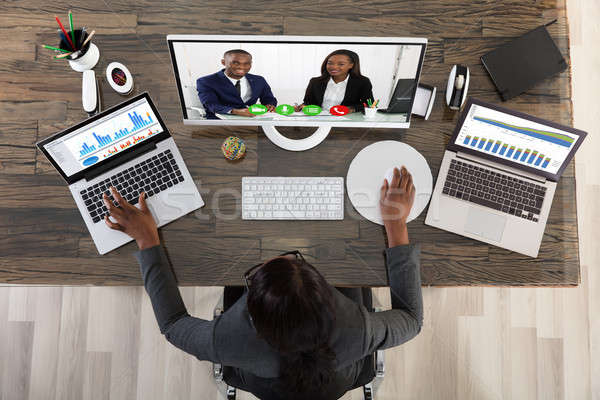 View Of Businesswoman Videoconferencing With Her Colleagues Stock photo © AndreyPopov