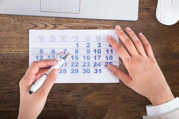 Businessperson Drawing Red Circle On Calendar Date Stock photo © AndreyPopov