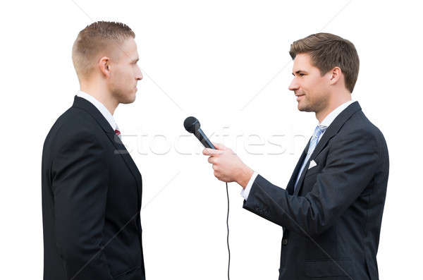 News Reporter Asking Questions To Businessman Stock photo © AndreyPopov