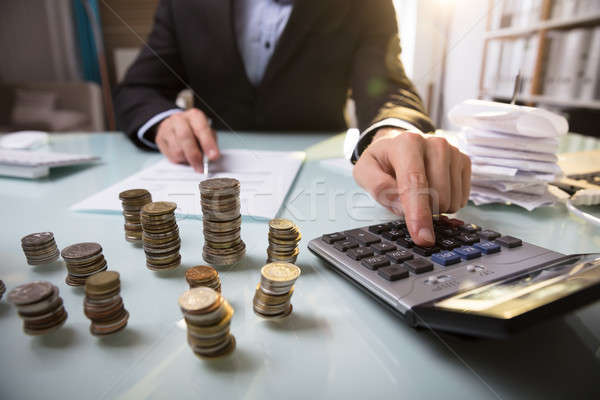 Close-up Of Stacked Coins On Desk Stock photo © AndreyPopov