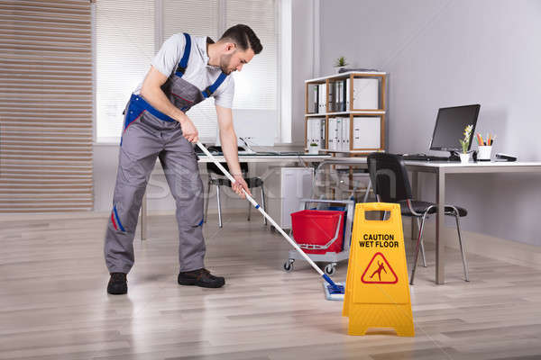 Stockfoto: Man · schoonmaken · kantoor · voorzichtigheid · nat