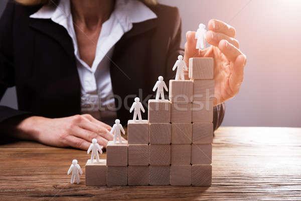 üzletember emberi lépcsőház kéz felfelé fakockák Stock fotó © AndreyPopov