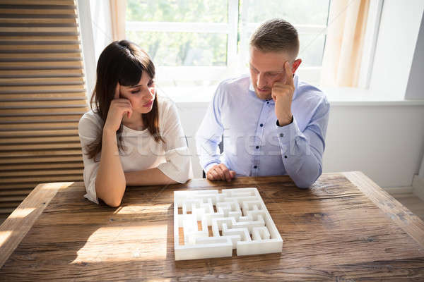 Two Contemplated Businesspeople Solving Maze Puzzle Stock photo © AndreyPopov