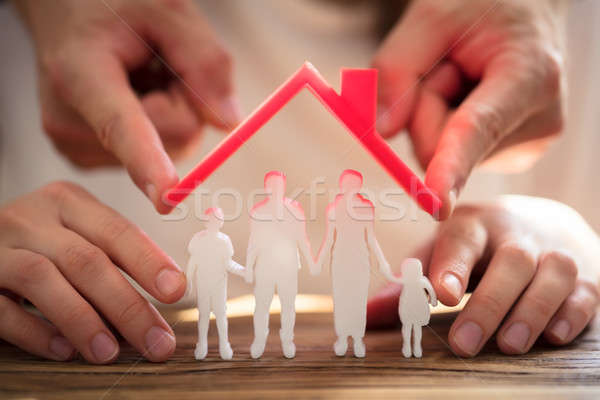 Two People Protecting Family Figures Stock photo © AndreyPopov