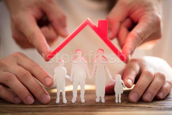 Deux personnes famille rouge toit bois bureau Photo stock © AndreyPopov