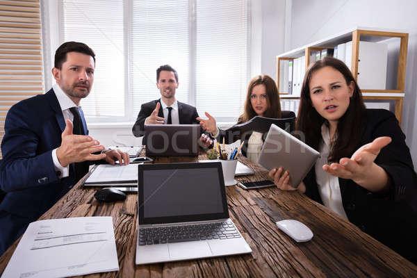 Portrait Of Shocked Businesspeople Stock photo © AndreyPopov