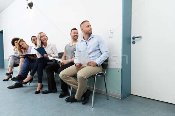 Candidates Looking At Door Stock photo © AndreyPopov