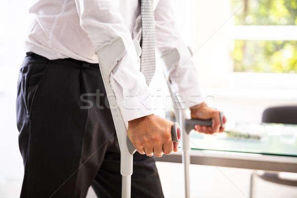 Disabili uomo stampelle view mano lavoro Foto d'archivio © AndreyPopov